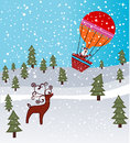 Santa is coming in hot air balloon reindeer waiting below Royalty Free Stock Photo