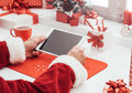 Santa connecting with a tablet Royalty Free Stock Photo