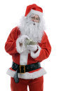 Santa counting the cost of christmas dollars isolated on a white background Stock Image