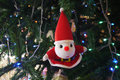 Santa doll on the christmas tree decorated close up Royalty Free Stock Photography