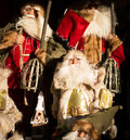 Santa dolls claus display in market stall on christmas market Stock Images