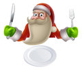Santa eating christmas dinner food Fotografia Stock Libera da Diritti