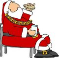 Santa eating a cookie and milk. Royalty Free Stock Photos
