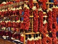 Santa fe hanging chili peppers display this was an artistic outside market of in new mexico i was told that these were used as Royalty Free Stock Photo