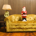 Santa figurine on couch. Stock Photos