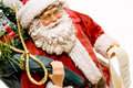 Santa Figurine/Gifts and List Royalty Free Stock Image