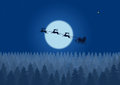 Santa flying through the night sky under the christmas forest. Santa sleigh driving over woods near big moon in night. Royalty Free Stock Photo