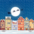 Santa flying through the night sky under the christmas old town illustration. Cartoon buildings background. City street