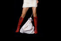 Santa girl and bag with gifts in red boots fur skirt staying Royalty Free Stock Photography