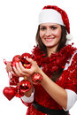 Santa girl with Christmas balls Royalty Free Stock Photography