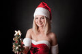 Santa girl with Christmas tree Stock Photo