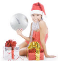 Santa girl with clock showing midnight Royalty Free Stock Photos