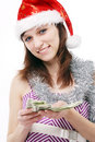 Santa girl counts the money Stock Image