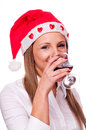 Santa girl drinking wine Stock Photography