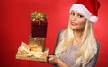 Santa girl with gift boxes over red background christmas portrait Stock Images