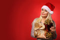Santa girl with gift boxes over red background christmas portrait Stock Image
