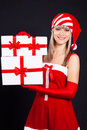 Santa girl holding the box with gifts. Royalty Free Stock Images