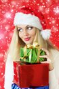 Santa girl holding gifts Stock Photography