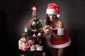 Santa girl open the gift. Stock Photo