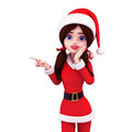 Santa girl is pointing towards blank Royalty Free Stock Images