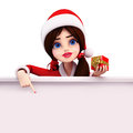 santa girl pointing towards blank sign Stock Photography