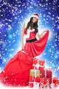 Santa girl ,presents,  blue abstract background Royalty Free Stock Photos