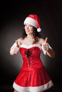 Santa girl shows OK Royalty Free Stock Photo