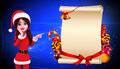 Santa girl standing before a big sign Stock Image