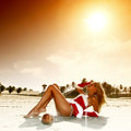 Santa girl vocation on beach Stock Photos