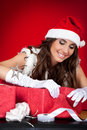 Santa girl wrapping xmas present Royalty Free Stock Photography