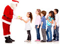 Santa giving Christmas presents Royalty Free Stock Photo