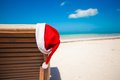 Santa hat on chair longue at tropical caribbean beach see my other works in portfolio Stock Image