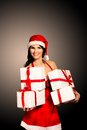Santa hat Christmas woman holding christmas gifts Royalty Free Stock Photo