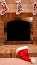 Santa hat on fireplace Stock Photos