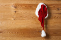 Santa hat hanging on the wall Royalty Free Stock Photo