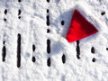 Santa hat on snow a covered wooden deck Royalty Free Stock Images
