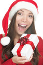 Santa hat woman holding gift excited Stock Photos