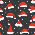 Santa hats background. Christmas seamless pattern vector. New year cartoon red hat. Royalty Free Stock Photo