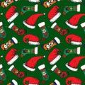 Santa hats, Christmas sock with Santa, bear, deer and snowman on green background Royalty Free Stock Photo