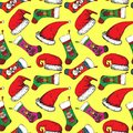 Santa hats, Christmas sock with Santa, bear, deer and snowman on yellow background Royalty Free Stock Photo