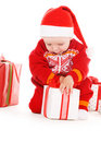 Santa helper baby with christmas gifts Royalty Free Stock Photos