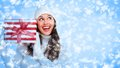 Santa helper christmas girl with a gift beautiful gifts on snowy background Stock Images