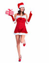 Santa helper christmas girl with a present beautiful gift isolated on white background Royalty Free Stock Photography
