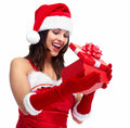 Santa helper christmas girl with a present beautiful gift isolated on white background Stock Photo