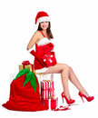 Santa helper christmas girl with a presents beautiful gifts isolated on white background Stock Photos