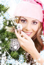 Santa helper girl decorating christmas tree Royalty Free Stock Images