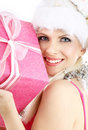 Santa helper girl with pink gift box Royalty Free Stock Photo