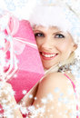 Santa helper girl with pink gift box and snowflake Stock Photo