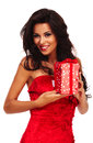 Santa helper girl on white background with long hair and red gif gift box Royalty Free Stock Image