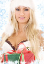 Santa helper girl in white lingerie with gift box Stock Photo